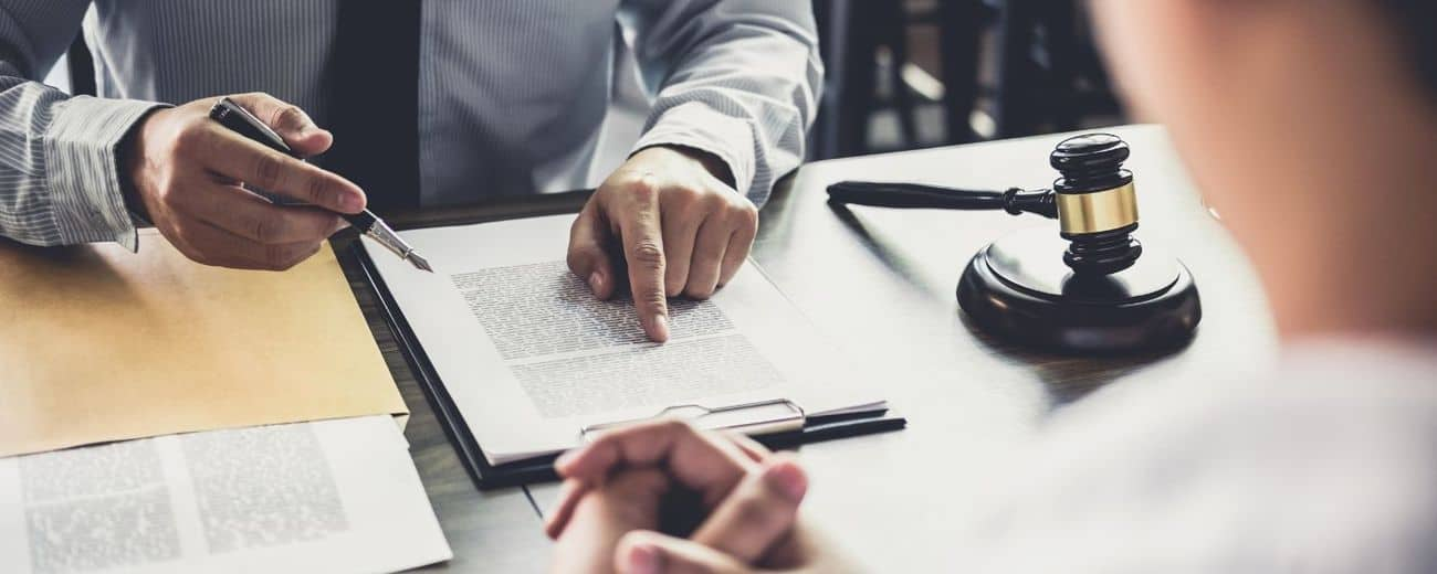 Why are you being asked to sign a Settlement Agreement?